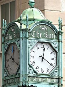 Sun Building clock